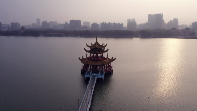 4k Aerial Footage of Tourists visiting Dragon and Tiger Pagodas in Kaohsiung City,Taiwan video