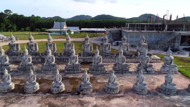 4k aerial movie shot fly over a group of buddha statue, Nakornsrithammarat, Thailand 4k aerial movie shot fly over a group of buddha statue, Nakornsrithammarat, Thailand sukhothai stock videos & royalty-free footage