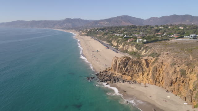 4k aerial of a beach in malibu, california - aerial beach stock videos & royalty-free footage