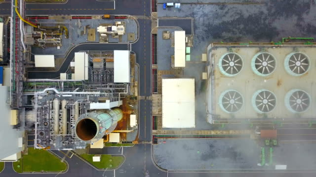 4k Aerial shot of combine cycle powerplant and cooling tower in Asia video