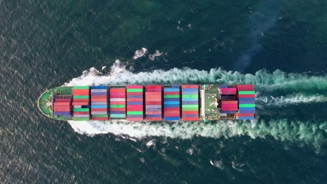 4k aerial shot track of container ship in ocean of south east asia - nave mercantile video stock e b–roll
