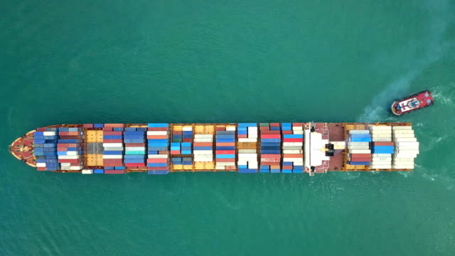 4k Aerial shot track of container ship in ocean video