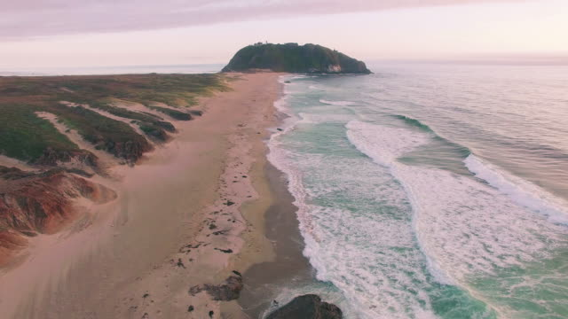 4k aerial view along beach waves sunset big sur video