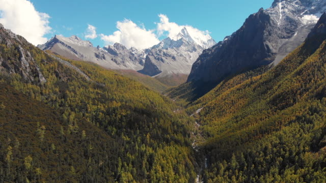 4k Aerial view and dolly in of Valley in autumn season at Yading Nature Reserve, China. 4k Aerial view and dolly in of Valley in autumn season at Yading Nature Reserve, China. high dynamic range imaging stock videos & royalty-free footage