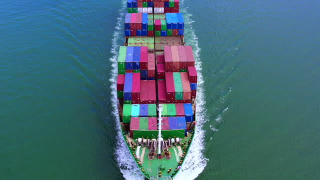4k, Aerial view container ship carrying container in import export business logistic and transportation of international by container ship in the open sea.