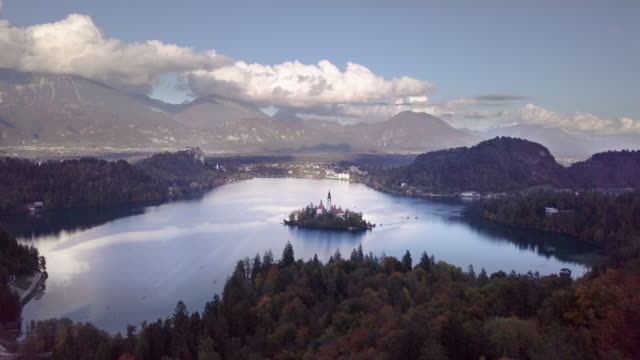 4k Aerial View from Drone,Dolly and Tilt Down to the Bled Church Bled island and Pilgrimage Church of the Assumption of Maria are located in Lake Bled,Slovenia. It is one of the most famous tourist destination in Slovenia. A travel boat is going to bled i