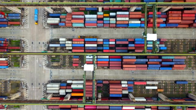 4k Aerial View of Industrial port with containers ship Aerial View of Industrial port with containers ship commercial dock stock videos & royalty-free footage