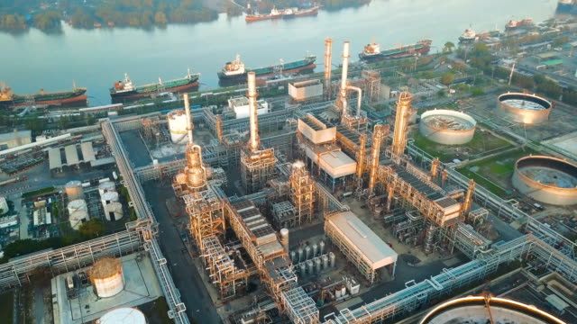 4k Aerial view of large oil refinery facilities at sunrise in asia video