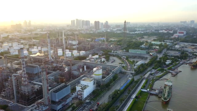 4k Aerial view of large oil refinery facilities in sunrise video