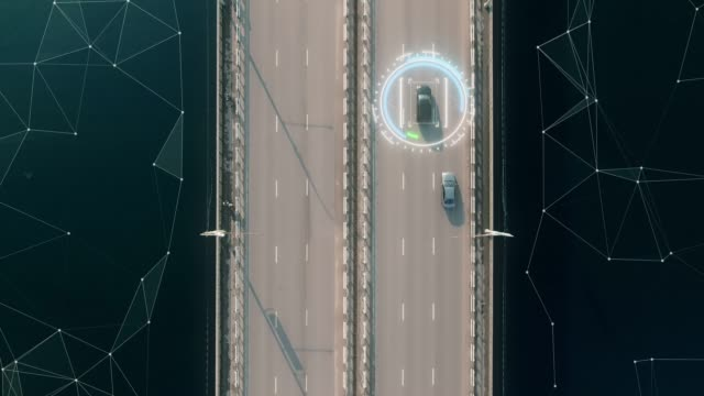 4k aerial view of self driving autopilot cars driving on a highway with technology tracking them, showing speed and who is controlling the car. visual effects clip shot. - środek transportu filmów i materiałów b-roll