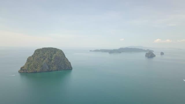 4k aerial view of tropical thai islands green sea and blue sky - four seasons filmów i materiałów b-roll
