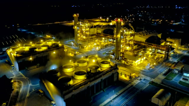 4k aerial view timelapse of combined cycle powerplant or fuel gas powerplant at night