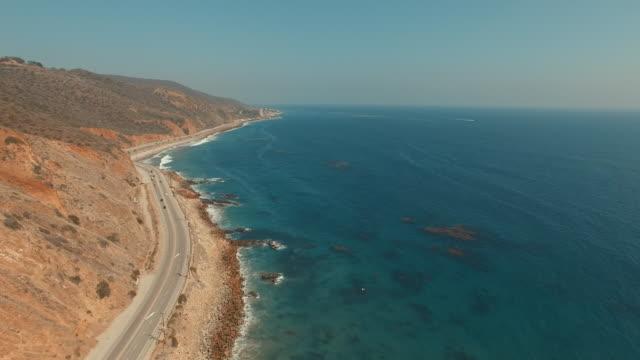 4k ascending aerial footage of a beach in Malibu, California video