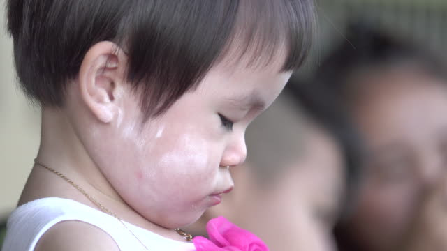 4k: Asian Little Girl Eating Sausage close-up video