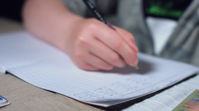 4k Authentic Shot of a Child Doing his Homework, close-up notebook video