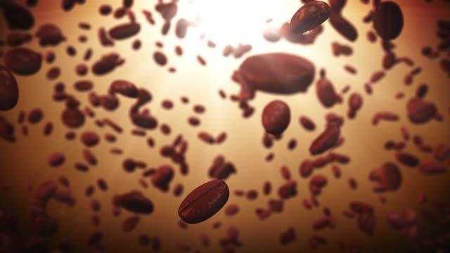 4k hintergrund mit fliegenden kaffeebohnen.geröstete kaffee glanz - koffeinmolekül stock-videos und b-roll-filmmaterial