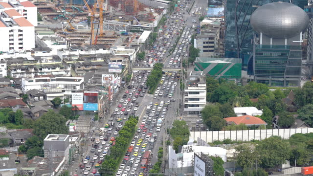 トラフィックと 4 k バンコク都市の景観 - 渋滞点の映像素材/bロール