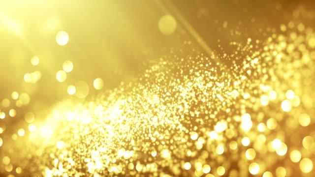 Video 4k Beautiful Bokeh and Light Beams (Bright Gold) - Loop