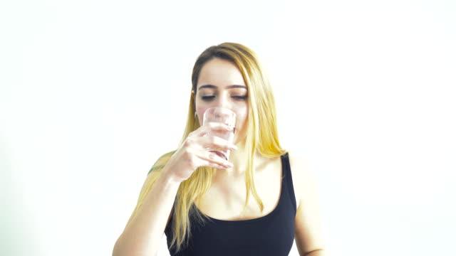 4k: Blonde Woman Taking a Pill video