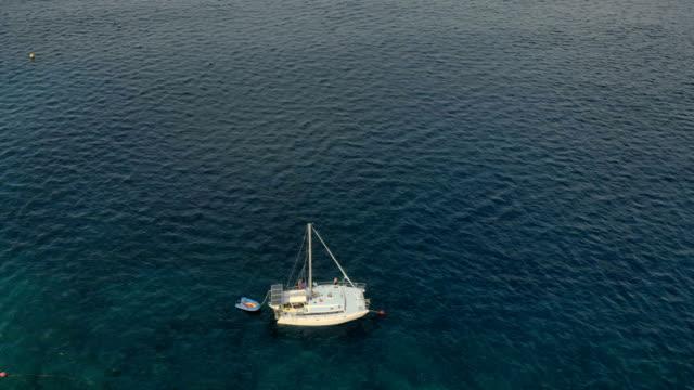 4k boat and beautiful sea water, drone overhead shot