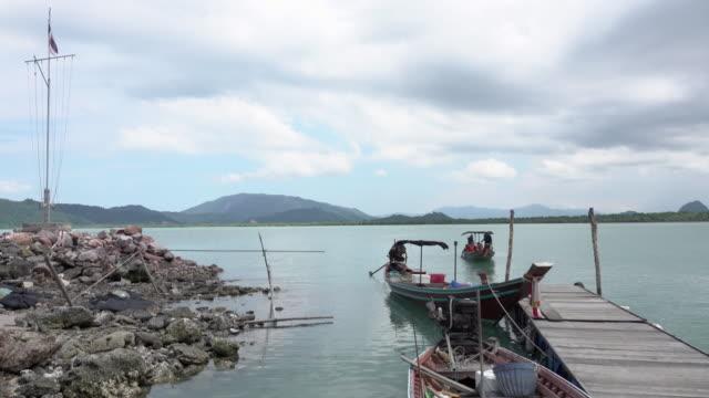 4k: boat on lake parking at port video