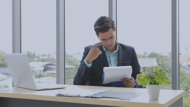 4k businessmen using notebook and fill serious about the work done until the headache
