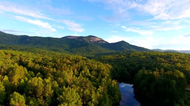 4k cinematic epic aerial of mountain lake at sunrise