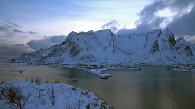 4k Clip Footage of top view land scape snow mountain with Cloudy and lake of Hamnoy Village in Lofoten Islands, Norway video