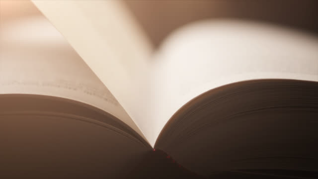4k Close-Up Of A Hand Turning A Page - Slow Motion - Book, Literature, Reading