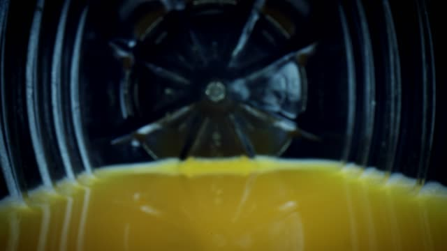 4k Close-up Zoom Out an Orange Juice Bottle with Straw video