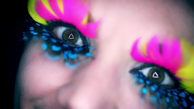 4k Colourful Woman Eyes Close-up with Feathers Eyelashes Flapping and Moving video
