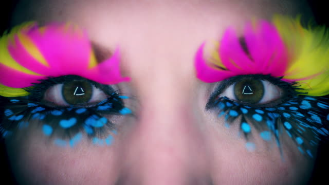 4k Colourful Woman Eyes Close-up with Feathers Eyelashes Flapping video