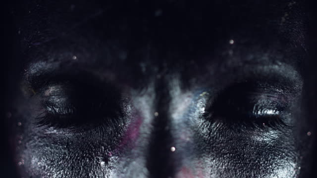 4k Cosmic Shot of a Woman with Alien make-up, Close-up of Blackout Eyes video