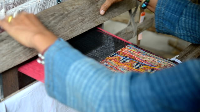 4k CU: Crafts in Thailand woman using loom to weave silk cloth in Thailand sari stock videos & royalty-free footage