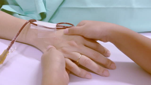 4k: Daughter holding mother hand in a hospital bed video