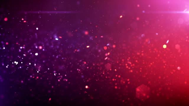 4 k defocused 입자 배경 (핑크 / 퍼플)-루프 - abstract background 스톡 비디오 및 b-롤 화면
