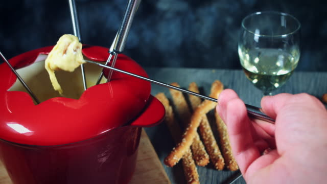 4k Dipping Bread in Mixed Cheese Fondue video