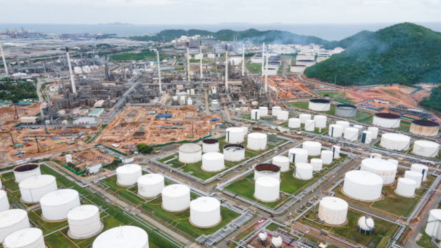 4k drone shot hyperlapse view oil refinery industry in night with Petrochemical plant and storage tank in large industry in asia