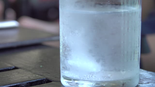 4k: Effervescent vitamins tablet melting video