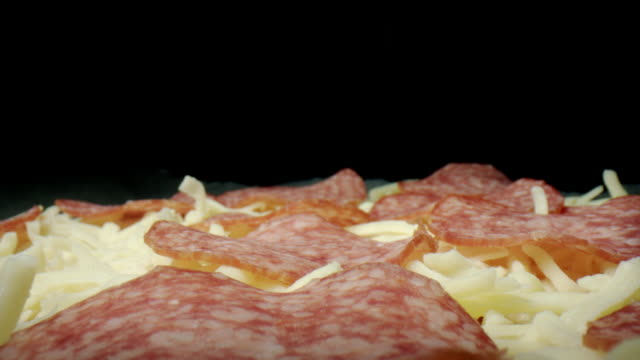 4k Extreme Close-up Macro Shot of Salami on Pizza video