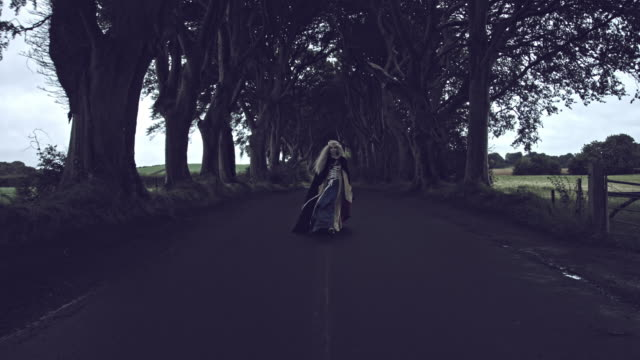 4k Fantasy Shot in Dark Hedges, Queen Walking to Camera video