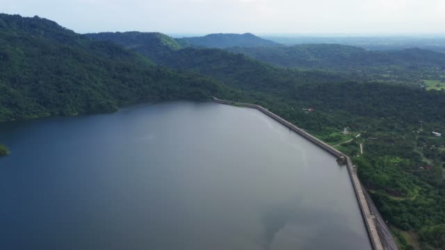 4k footage of Aerial view of mountain dam in the forest