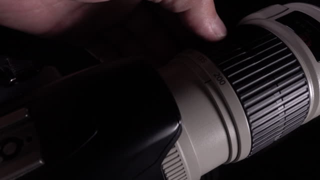 4k Footage of Man hand Zooming Lens video
