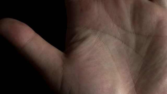 4k footage of palm hand on black background - palm of hand stock videos & royalty-free footage