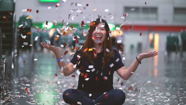 4k footage scene of attractive Asian woman celebrating and throwing with confetti in the room, Celebration with happy new year and Party concept Footage scene of attractive Asian woman celebrating and throwing with confetti in the room, Celebration with happy new year and Party concept, 4k clip congratulating stock videos & royalty-free footage