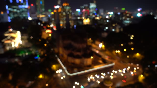 4k footage scene of speed blurred defocused light from City life of Notre-Dame Cathedral Basilica of Saigon from top view at night time bokeh in Ho Chi Minh City, Vietnam, Cityscape and Architecture Concept