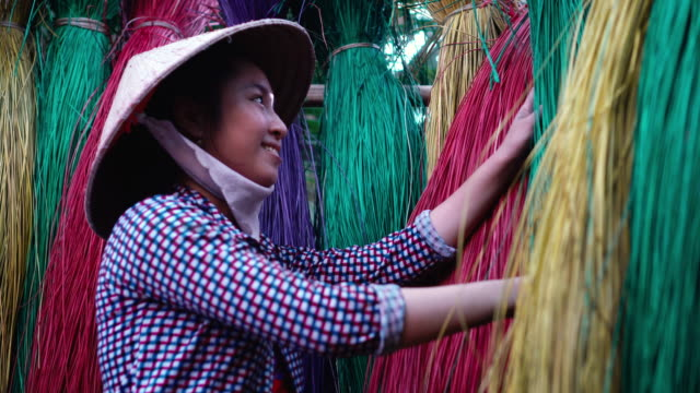 4k footage scene side of Vietnamese female craftsman drying and making traditional vietnam mats in the old village at Dinh Yen, Dong Thap, Vietnam, Tradition artist concept