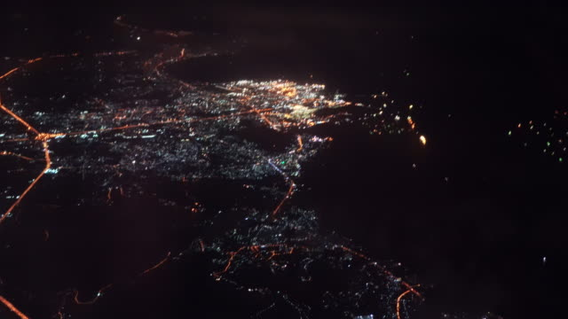 4k footage scene Top view of Airplane flying over the city at night after take off from the airport, Travel and transportation concept