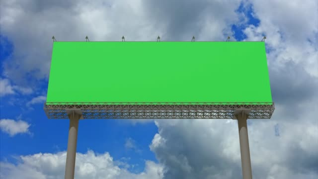 4k footage,Empty billboard with chromakey green screen on time lapse cloud and blue sky.Advertisement billboard concept.