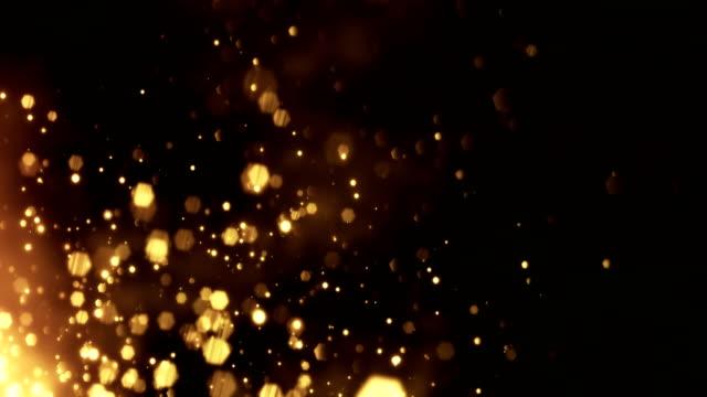 vidéos et rushes de 4 k des particules d'or diagonale mouvement - arrière-plan animation - bouclables - bonne chance